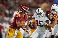 LOS ANGELES, CA - SEPTEMBER 11: Kedon Slovis #9 of the USC Trojans scrambles under pressure from Ricky Miezan #45 of the Stanford Cardinal during a game between University of Southern California and Stanford Football at Los Angeles Memorial Coliseum on September 11, 2021 in Los Angeles, California.