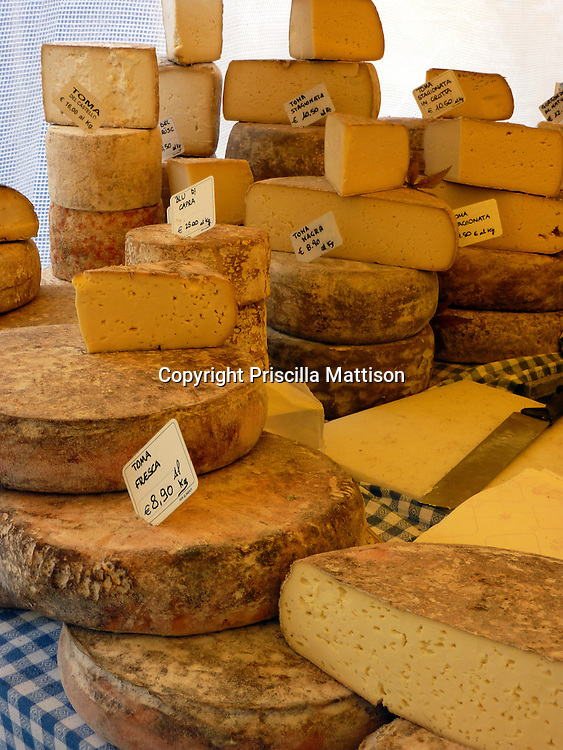 Turin, Italy - February 5, 2012:  Cheese is stacked on display.