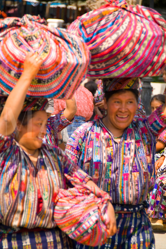 Colorful print patterned clothes of the women in the famous market day color of the Highlands in village of Solola Guatemala cover type vertical imag