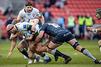 21st March 2021; AJ Bell Stadium, Salford, Lancashire, England; English Premiership Rugby, Sale Sharks versus London Irish; Ollie Hoskins of London Irish is tackled by Lood de Jager of Sale Sharks