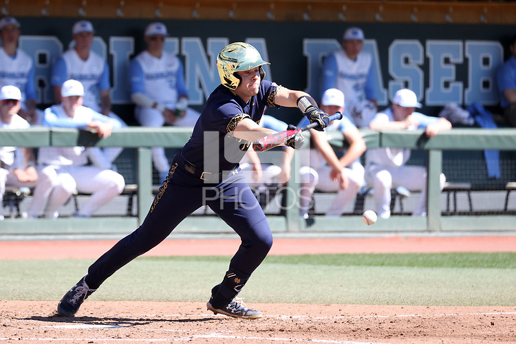 CHAPEL HILL, NC - MARCH 08: Carter Putz #4 of the University of Notre Dame bunts the ball during a game between Notre Dame and North Carolina at Boshamer Stadium on March 08, 2020 in Chapel Hill, North Carolina.