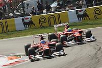 SPANISH FERNANDO ALONSO ON FERRARI F2012,PASSING BRAZILIAN TEAMMATE FELIPE MASSA. .Monza 9/9/2012 .Formula 1.Foto Insidefoto / Bernard Asset / Panoramic .Italy Only