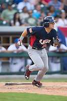 Chris Okey (25) of the US Collegiate National Team starts down the first base line during the game against the Cuban National Team at BB&T BallPark on July 4, 2015 in Charlotte, North Carolina.  The United State Collegiate National Team defeated the Cuban National Team 11-1.  (Brian Westerholt/Four Seam Images)