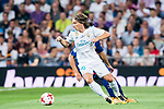 Luka Modric (r) of Real Madrid is tackled by Andre Filipe Tavares Gomes of FC Barcelona during their Supercopa de Espana Final 2nd Leg match between Real Madrid and FC Barcelona at the Estadio Santiago Bernabeu on 16 August 2017 in Madrid, Spain. Photo by Diego Gonzalez Souto / Power Sport Images