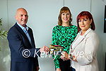 The Kerry's Eye Staycation competition winner Ann Marie Dineen, Ballymcquinn Ardfert getting her prise of a luxury stay at the Brehon hotel from Brendan Kennelly, Marketing manager, Kerry's Eye in centre is Ann Marie's sister Siobhan Sheehy.