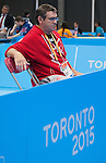 Toronto, ON - Aug 8 2015 - Coach John MacPherson watches as Martin Pelletier competes in Group C MS9 table tennis in the ATOS Markham Centre during the Toronto 2015 Parapan American Games  (Photo: Matthew Murnaghan/Canadian Paralympic Committee)