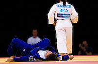 04 DEC 2011 - LONDON, GBR - Karine Berger (FRA) (in blue, on left) recovers after being beaten by Maria Portela (BRA) (in white, on right) during the London International Judo Invitational and 2012 Olympic Games test event at the ExCel Exhibition Centre in London, Great Britain (PHOTO (C) NIGEL FARROW)