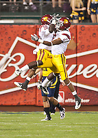 San Francisco, CA - October 13, 2011: USC linebacker Dion Bailey (18) and wide receiver Robert Woods (2) celebrate Bailey's interception. Cal Bears vs USC at AT&T Park in San Francisco, California. Final score Cal Bears 9, USC 30.