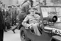 Winston Churchill in a jeep outside the German Reichstag during a tour of the ruined city of Berlin, 16 July 1945. Prime Minister Winston Churchill sits in a jeep outside the Reichstag during a tour of the ruined city of Berlin, Germany on 16 July 1945.