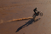 Camel catcher on motor bike, Central Australia, Northern Territory, Australia.