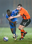 St Johnstone v Dundee United....22.02.11 .Cleveland Taylor and Keith Watson.Picture by Graeme Hart..Copyright Perthshire Picture Agency.Tel: 01738 623350  Mobile: 07990 594431