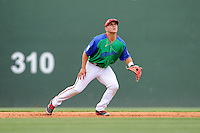 Third baseman Michael Chavis (11) of the Greenville Drive in a game against the Augusta GreenJackets on Sunday, April 12, 2015, at Fluor Field at the West End in Greenville, South Carolina. Chavis is a first-round pick of the Boston Red Sox in the 2014 First-Year Player Draft. Augusta won, 2-1. (Tom Priddy/Four Seam Images)