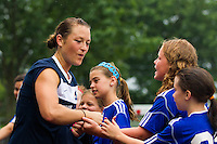 Sky Blue FC midfielder Brittany Bock (10) greets fans before the game. Sky Blue FC and the Boston Breakers played to a 0-0 tie during a National Women's Soccer League (NWSL) match at Yurcak Field in Piscataway, NJ, on July 13, 2013.