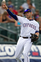 Round Rock Express third baseman Mike Olt (20) makes a throw to first base during the Pacific Coast League baseball game against the New Orleans Zephyrs on June 30, 2013 at the Dell Diamond in Round Rock, Texas. Round Rock defeated New Orleans 5-1. (Andrew Woolley/Four Seam Images)