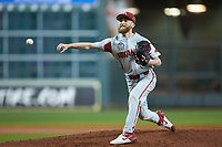 Arkansas Razorbacks relief pitcher Marshall Denton (29) delivers a pitch to the plate against the Texas Longhorns in game six of the 2020 Shriners Hospitals for Children College Classic at Minute Maid Park on February 28, 2020 in Houston, Texas. The Longhorns defeated the Razorbacks 8-7. (Brian Westerholt/Four Seam Images)