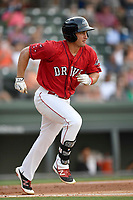 First baseman Mitchell Gunsolus (22) of the Greenville Drive runs out a batted ball in a game against the Kannapolis Intimidators on Friday, July 14, 2017, at Fluor Field at the West End in Greenville, South Carolina. Greenville won, 2-0. (Tom Priddy/Four Seam Images)