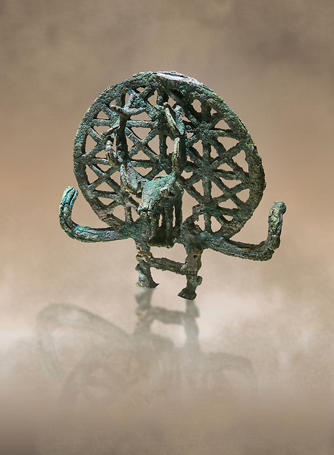 """Bronze Age Hattian ceremonial standard known as """"Sun Disks"""" from possible Royal Bronze Age grave (2500 BC - 2200 BC)- Alacahoyuk - Museum of Anatolian Civilisations, Ankara, Turkey. Against a warm art background"""