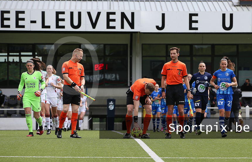 Players enter the pitch, assistant referee Tom Dillen (L) and assistant referee Bryan Bijnens (R) looking at referee Tom Stevens putting the match ball on the ground abefore a female soccer game between Oud Heverlee Leuven and AA Gent Ladies on the 9 th matchday of play off 1 in the 2020 - 2021 season of Belgian Womens Super League , saturday 22 nd of May 2021  in Heverlee , Belgium . PHOTO SPORTPIX.BE | SPP | SEVIL OKTEM