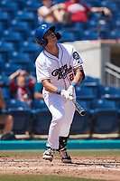 Shawn Goosenberg (2) of the Kannapolis Cannon Ballers follows through on his swing against the Lynchburg Hillcats at Atrium Health Ballpark on August 29, 2021 in Kannapolis, North Carolina. (Brian Westerholt/Four Seam Images)