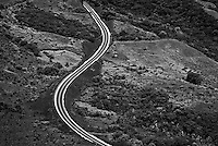 Aerial of a winding road in Black and white Palau Micronesia