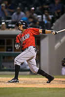 Gustavo Nunez (12) of the Indianapolis Indians follows through on his swing against the Charlotte Knights at BB&T BallPark on June 20, 2015 in Charlotte, North Carolina.  The Knights defeated the Indians 6-5 in 12 innings.  (Brian Westerholt/Four Seam Images)