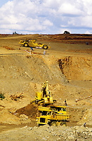 Earth movers stripping overburden to open up new opencast mine