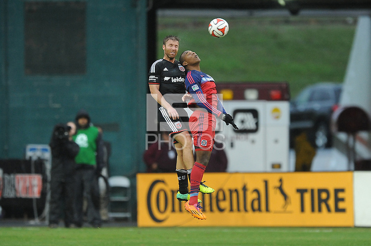 Washington, D.C.- March 29, 2014. Jeff Parke (2) of D.C. United heads the ball against Juan Luis Anangono of the Chicago Fire. The Chicago Fire tied D.C. United 2-2 during a Major League Soccer Match for the 2014 season at RFK Stadium.