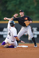 Second baseman Ryan Adams #3 of the Frederick Keys tries to turn a double play as John Curtis #24 of the Winston-Salem Dash slides into second base at Wake Forest Baseball Stadium August 8, 2009 in Winston-Salem, North Carolina. (Photo by Brian Westerholt / Four Seam Images)