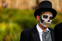 A Mexican boy, dressed as La Catrina, a Mexican pop culture icon representing the Death, takes part in the Day of the Dead celebrations in Oaxaca, Mexico, 31 October 2019. Day of the Dead (Día de Muertos), a religious holiday combining the death veneration rituals of Pre-Hispanic cultures with the Catholic practice, is widely celebrated throughout all of Mexico. Based on the belief that the souls of the departed may come back to this world on that day, people gather together while either praying or joyfully eating, drinking, and playing music, to remember friends or family members who have died and to support their souls on the spiritual journey.