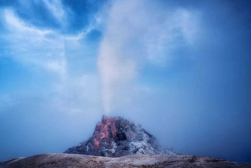 White Dome Gyser erupting. Yellowstone National Park, Wyoming