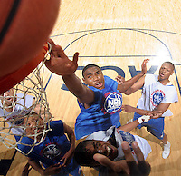 Kevin Jones reaches for the rebound during the NBA Top 100 Camp held Saturday June 23, 2007 at the John Paul Jones arena in Charlottesville, Va. (Photo/Andrew Shurtleff)