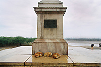 Feral dogs sleep at the foot of the monument built to mark the spot from which King George V proclaimed himself Emperor of India during a ceremony in 1911. This now desolate spot is in Coronation Park which lies on the Grand Trunk Road on the outskirts of Delhi.