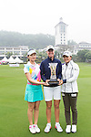(left-right) Shi Yu Ting of China, Nichole Broch Larsen of Denmark, and KO Jim Young of South Korea, pose with the trophy at the beginning of the World Ladies Championship 2016 on 09 March 2016 at Mission Hills Olazabal Golf Course in Dongguan, China. Photo by Victor Fraile / Power Sport Images