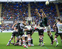 Danny Care of Harlequins clears his line as Jamie Gibson of London Irish attempts to block it during the Aviva Premiership match between London Irish and Harlequins at the Madejski Stadium on Sunday 28th October 2012 (Photo by Rob Munro)