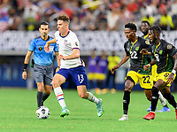 DALLAS, TX - JULY 25: Matthew Hoppe #13 of the United States brings the ball up the field with Devon Williams #22 and Oniel Fisher #8 of Jamaica right behind him during a game between Jamaica and USMNT at AT&T Stadium on July 25, 2021 in Dallas, Texas.