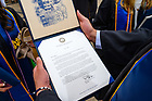 May 23, 2021; A graduate reads the letter in the diploma folder. Graduates were notified well in advance of Commencement weekend that their diplomas would be mailed. (Photo by Matt Cashore/University of Notre Dame)