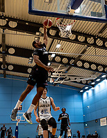 Lacey James of Surrey Scorchers with a dunk during the BBL Championship match between Surrey Scorchers and Newcastle Eagles at Surrey Sports Park, Guildford, England on 20 March 2021. Photo by Liam McAvoy.