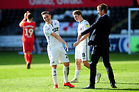 Connor Roberts of Swansea City and Graham Potter Manager of Swansea City celebrate at full time during the Sky Bet Championship match between Swansea City and Middlesbrough at the Liberty Stadium in Swansea, Wales, UK. Saturday 06 April 2019