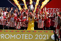 29th May 2021; Wembley Stadium, London, England; English Football League Championship Football, Playoff Final, Brentford FC versus Swansea City; Goalkeeper David Raya of Brentford lifts the Sky Bet EFL Championship Plays-off Trophy with his team mates after they won 2-0 and promoted to the premier league
