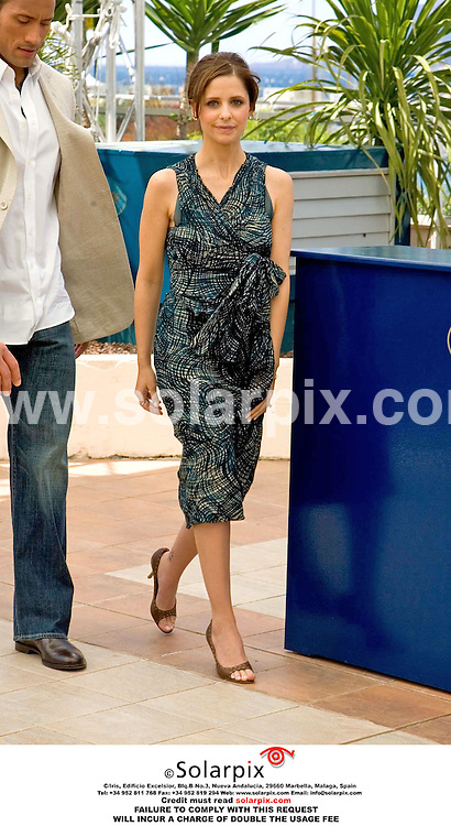 ALL ROUND PICTURES FROM SOLARPIX.COM..The Rock and Sarah Michelle Gellar attend a photocall for their new film Southland Tales at 2006 Cannes Film Festival.  Job Ref: 2387/BOG.MUST CREDIT SOLARPIX.COM OR DOUBLE FEE WILL BE CHARGED.
