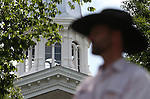 Travis Gerber sits on horseback in front of the Capitol in Carson City, Nev., on Friday, May 30, 2014. Gerber and his father Grant rode from Carlin to Carson City to deliver a petition to the governor calling attention to the ongoing fight between ranchers and the BLM over grazing on public lands. <br /> Photo by Cathleen Allison