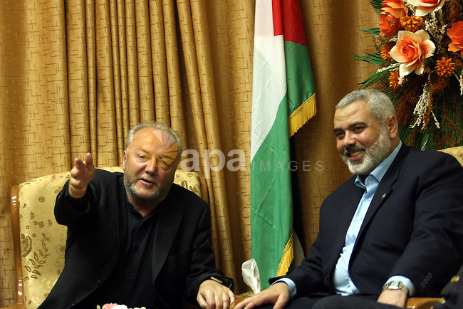 Senior Hamas leader Ismail Haniyeh hugs British politician George Galloway during their meeting in Gaza, in this picture released by Haniyeh's office March 11, 2009. About 50 British volunteers and 100 vehicles carrying food, clothing and medicine passed through Egypt's Rafah border crossing, a Hamas border official said..