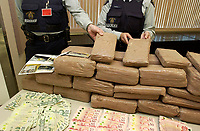 December 04,  2002, Montreal, Quebec, Canada; <br /> <br /> olicemen show drug, guns and money<br /> seized during a recent drug bust,to the medias,<br />  December 04, 2002 in Montreal, Canada.<br /> <br /> 15 people presumably involveld in a 2 billion Can $ drug deal, where arrested after a joint operation by the RCMP, Quebec Province and Montreal City Police.<br /> <br /> <br /> <br /> (Mandatory Credit: Photo by Sevy - Images Distribution (©) Copyright 2002 by Sevy<br /> <br /> NOTE :  D-1 H original JPEG, saved as Adobe 1998 RGB.<br />  Uncompressed and uncropped original  size file available on request.