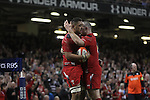 Ken Owens congratulates Taulupe Faletau after the Wales number 8 scores in the corner.<br /> RBS 6 Nations 2014<br /> Wales v Scotland<br /> Millennium Stadium<br /> <br /> 15.03.14<br /> <br /> ©Steve Pope-SPORTINGWALES