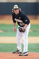 Wake Forest Demon Deacons starting pitcher Garrett Kelly (28) looks to his catcher for the sign against the Towson Tigers at Wake Forest Baseball Park on March 1, 2015 in Winston-Salem, North Carolina.  The Demon Deacons defeated the Tigers 15-8.  (Brian Westerholt/Four Seam Images)