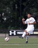 Boston College defender/forward Kevin Mejia (12) passes the ball. Boston College defeated Quinnipiac, 5-0, at Newton Soccer Field, September 1, 2011.