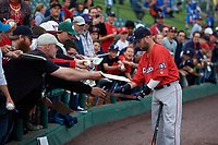 Pawtucket Red Sox second baseman Dustin Pedroia (15) signs autographs for fans before a game against the Rochester Red Wings on May 19, 2018 at Frontier Field in Rochester, New York.  Rochester defeated Pawtucket 2-1.  (Mike Janes/Four Seam Images)