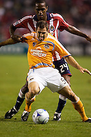 Houstons Brian Mullan defends against Chivas forward Atiba Harris. The Houston Dynamo and Chivas USA played to a 1-1 tie at Home Depot Center stadium in Carson, California on Saturday October 25, 2008. Photo by Michael Janosz/isiphotos.com