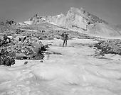 0405-J01. Summit of Mt. Hood. Climber with alpenstock. Ca. 1920s
