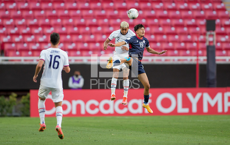 ZAPOPAN, MEXICO - MARCH 21: Julian Araujo #2 of the United States and Rafael Mata #19 of the Dominican Republic battle in the air for a ball during a game between Dominican Republic and USMNT U-23 at Estadio Akron on March 21, 2021 in Zapopan, Mexico.